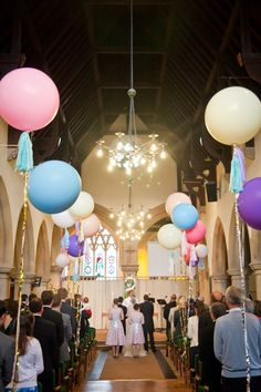 Balloons in the church aisle - A Mismatched Homespun Wedding - Sarah and Tom by Mia Photography on whimsical wonderland weddings