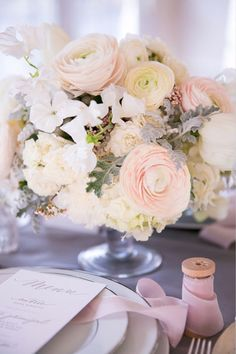 Blush and white rununculus make such a lovely wedding centerpiece for a traditional wedding.