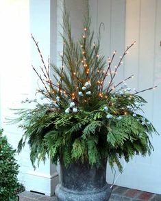 lighted branches and greens. I have the lighted branches for sale! Christmas Urns, Natural Christmas, Outdoor Christmas Decorations, Rustic Christmas, Winter Christmas, Christmas Lights, Christmas Time, Christmas Wreaths, Christmas Crafts