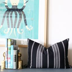 """A black + white woven stripe, lumbar pillow with a punctuating global feeling, perfect for your top of bed or sofa.Size: 14"""" x 20"""" Made in Canada 100% Cotton"""
