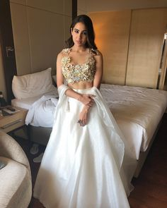Sara Ali Khan is one of the youngest actors who made her Bollywood debut with a bang. With two blockbuster films like Simmba and Kedarnath, this Pataudi girl will go a long way. Bollywood Lehenga, Indian Lehenga, Lehenga Choli, Bollywood Fashion, Anarkali, Bollywood Actress, Lehenga White, Plain Lehenga, Indowestern Lehenga