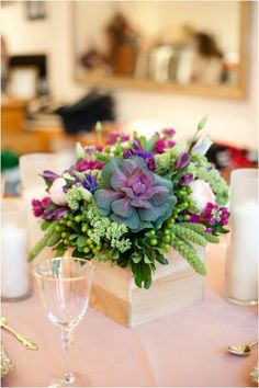 Great centerpiece from Style Me Pretty, succulents seem so romantic lately
