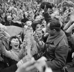 Dutch civilians celebrating the arrival of the I Canadian Corps in Utrecht as the Canadian Army liberates the Netherlands from Nazi occupation. 7 May 1945