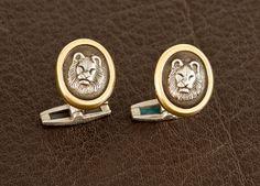 "Head of lion in sterling cameo set in 14kt gold bezel.  5/8"" x 3/4"""