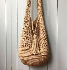 Crochet Tote Bag PATTERN, Bucket Bag Crochet Pattern, Boho Crochet, Boho Bag, Purse Pattern, Hand Bag, Slouchy Bag, Crochet Sac, Summer Tote. This KnotYourselfOut crochet tote bag is named: BUCKET BAG BEAUTY. I have to say it -- I think this bag is beautiful. I had a lot of fun designing it and I can't wait to start using it. In addition to being very pretty, it is also very roomy. The tassel gives the bag a lovely slouchy look and can hang down on one side, or flip over the top to keep…