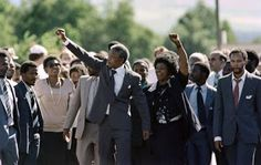 Black History Month Photos Anti-apartheid leader and African National Congress (ANC) member Nelson Mandela (C, L) and his wife Winnie raise fists upon Mandela's release from Victor Verster prison on February 1990 in Paarl.