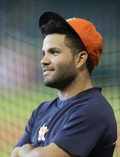 Jose Altuve Photos - Jose Altuve #27 of the Houston Astros listens in on a conversation during batting practice at Minute Maid Park on August 17, 2015 in Houston, Texas. - Tampa Bay Rays v Houston Astros