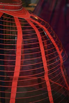 Detail of tapes and back of 1860s cage crinoline at the V&A Museum. Photo from Fashion Pearls of Wisdom blog. [jrb]