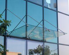 glass canopy on curtain wall