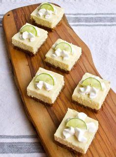 Key Lime Cheesecake Bars with Raspberry Sauce   Yummy Noises Easy Homemade Desserts, Easy Cake Recipes, Dessert Recipes, Key Lime Cheesecake Bars, Best Key Lime Pie, Healthy Yogurt, Refreshing Desserts, Raspberry Sauce, Graham Cracker Crumbs