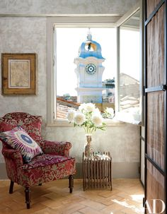 Centuries of style mingle in the Rome apartment of interior designer Livia Rebecchini and her family. A bathroom window frames a bell tower; the drawing is by Sandro Chia, the chair is century, and the table is by Gio Ponti. Architectural Digest, Rome Apartment, Romantic Room, Italian Home, Italian Farmhouse, Relax, Bathroom Windows, Traditional Bathroom, Window Design