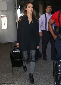 Beautiful in black: Jessica Alba looked comfortable and chic in her black blouse with lace...