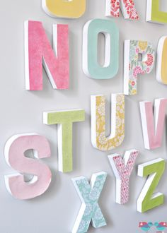 How to Make your own Letter Wall - The Love Nerds *W/ Directions*  I've had these cardboard letters for YEARS now but kept going back and forth on what to do with them...whether to paint them, wrap in yarn, or decoupage them...BUT this has made up my mind!