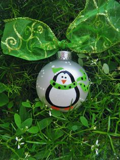 Personalized Handpainted Penguin Christmas Ornament - Penguin with Green Scarf - Glass Ball Christmas Ornament. $17.50, via Etsy.