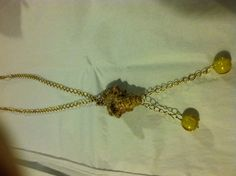Shell found while diving at Kaanapali Beach with hand blown glass beads on brass chain with heart toggle clasp