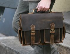 The classic shape (without the sharp corners), buckles, leather exterior, and practical interior compartments help make this bag a timeless addition to any working-man's wardrobe. The+whole process is entirely handmade of pure, non-machining Briefcase For Men, Leather Briefcase, Cowhide Leather, Leather Men, Leather Bags For Men, Leather Jackets, Pink Leather, Leather Projects, Leather Crafts