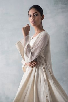 HIGH SUMMER Kavi is an easy range of contemporary daywear in shades of mogra, with tonal textures, delicate hand-embellishments and airy cuts. Simple Kurti Designs, Kurta Designs, Indian Party Wear, Indian Wear, Indian Dresses, Indian Outfits, Velvet Suit Design, Suits For Women, Clothes For Women