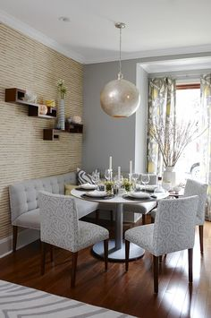 If you're forced to put your kitchen table in the corner, put a solid coloured bench and add statement chairs