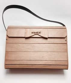 Large size wooden handbag with short leather handle.