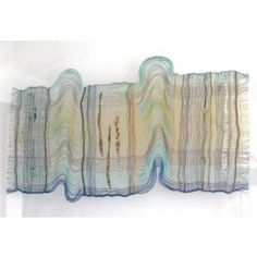 Handwoven transparency in painted silk threads with mixed media inserts. The work is held between 2 sheets of glass, and although it is flat appears 3D in certain lights by June Croll.