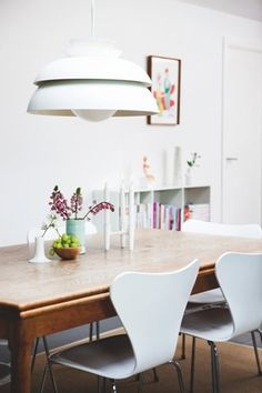 the old table, modern lamp and chairs, love it