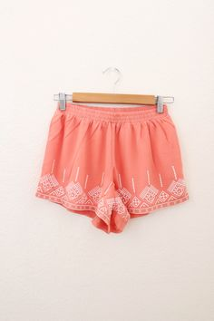 Loose, flowy shorts with aztec pattern embroidered on it.