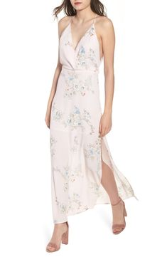 Free shipping and returns on Surplice Maxi Dress at Nordstrom.com. <p>Thigh-high slits add movement to the sweeping skirt of a beautifully draped maxi dress with a plunging surplice neckline and playful cutout at the back.</p>