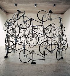 Ai Weiwei: Forever, the earliest work in the exhibition, has connections back to the artist's fascination with the father-figure of conceptual art, Marcel Duchamp. 42 bicycles of the 'Forever' brand, the favourite means of transport of the Chinese for decades, have been ingeniously stacked in a cylindrical tower, a 'cycle' that goes nowhere, since all the handlebars and pedals have been removed. (2003)