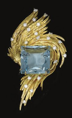 AQUAMARINE AND DIAMOND BROOCH, CHAUMET, CIRCA 1970 The textured yellow gold bird set with a square-cut aquamarine, brilliant-cut diamonds and circular-cut emeralds, signed Chaumet Paris, French assay and maker's marks.