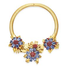 Van Cleef & Arpels | A Retro Blue and Yellow Sapphire, Ruby and Gold 'Passe-Partout' Necklace, by Van Cleef & Arpels, circa 1940