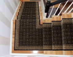 Here's how the same set of stairs look after a stair runner installation.