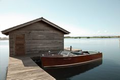 nice old chris craft and boathouse