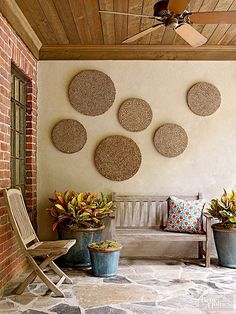 A protected patio can indulge in interior-style design because its furnishings and accessories are sheltered from the elements. We love these wooden porch pieces! http://www.bhg.com/home-improvement/patio/designs/quick-patio-pick-me-ups/?socsrc=bhgpin051315porchartwork&page=14