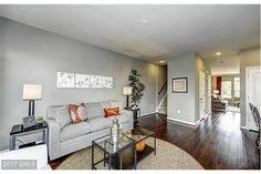 Get cozy by the fireplace in the family room in this lovely townhouse! This beautiful home also includes granite counter tops and upgraded cabinets in the kitchen!