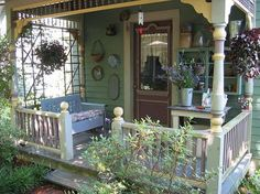I could see myself sitting on this front porch with a tall glass of ice tea. Maybe even if a house didn't have all the architectural details that this one has, by just adding some flowers, a cozy bench and some country whimsy is all it would take to make a front porch more inviting.