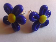 These earrings are made by myself. More information is on my Etsy page:  https://www.etsy.com/listing/231891761/hand-made-blue-yellow-colour-flower-stud?ref=listing-shop-header-1