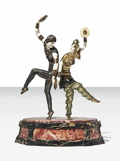 DEMETRE CHIPARUS (1888-1950) 'RUSSIAN DANCERS', CIRCA 1925 patinated, gilt and cold-painted bronze, and ivory, on marble base 16 ½ in. (42 cm.) high base engraved D. H. Chiparus.