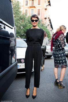 black boatneck blouse + black high-waisted trousers + black heels + black sunglasses