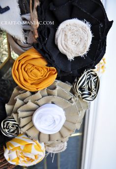 I finished up my DIY Fall Wreath today!!! {{Man' I love fall crafting/decorating}} BEST PART… it didn't cost me one penny!!!! whooOOP! I headed out to my garage and found my OLD fall wreath that I made a couple years ago. I tore everything off, then I rummaged through all my fabric, some old shirts …