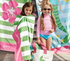 Having fun in the sun with friends and our Classic Rugby Hibiscus Beach Towels