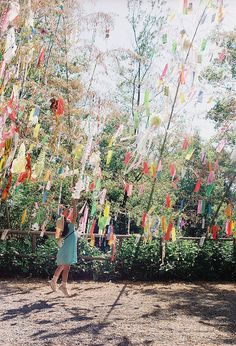 Like this idea. Make the ribbons large enough for everyone to write a note to the couple and tie it to the string. They the string an be recycled like a prayer flag for the couples house