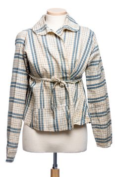 Woman's bodice, short-gown, or bedgown, early 19th century. A utilitarian garment, this indigo blue and natural checked cotton fabric has been pieced from fragments. Charleston Museum
