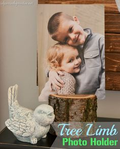 Tree limb photo holder.