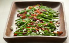 5-Minute Recipe: Green Beans with Goat Cheese, Cranberries, and Almonds:•1 1/2 lb. green beans, washed and trimmed   •2 tablespoons extra-virgin olive oil   •1 tablespoon sherry vinegar   •1/2 teaspoon sea salt   •Ground black pepper to taste   •2/3 cup dried cranberries   •1 (4-ounce) log goat cheese, crumbled   •Optional: 1/4 cup almonds and/or cooked bacon (crumbled)