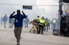 First responders rush to where two explosions occurred along the final stretch of the Boston Marathon on Boylston Street in Boston, Massachusetts, U.S., on Monday, April 15, 2013.