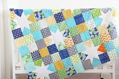 "Great idea for a cute (and easy!) baby quilt. Make star blocks then add 9 patch blocks made with 4"" blocks. For more detail see: http://www.vanessachristenson.com/2013/03/v-and-co-reverse-hopscotch-quilt-top.html"