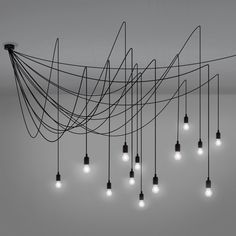 A tentacular ceiling lamp, a lighting mesh with endless combinations. Ceiling lamp with 14 bulbs Design: Selab Material: Silicon, plastic, metal Cables: 14 x 4 mt . Ceiling Pendant, Pendant Lamp, Ceiling Lamps, Floor Lamps, How To Make A Chandelier, Lumiere Led, Luminaire Design, Ceiling Rose, Modern Ceiling