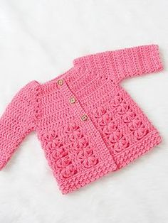 Crochet Pattern Sweaters Textured Crochet Baby Sweater Pattern - Crochet Dreamz - This crochet baby sweater includes 6 sizes from baby to Toddler. The pattern has an easy to work Raglan shaping and a textured body with floral stitches. Crochet Baby Sweater Pattern, Crochet Baby Sweaters, Baby Sweater Patterns, Baby Girl Sweaters, Crochet Coat, Baby Clothes Patterns, Crochet Cardigan Pattern, Baby Girl Crochet, Crochet Baby Clothes