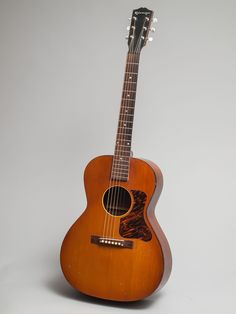 """1940 Gibson made Kalamazoo KG-12 in very good condition.  Rare model in the Kalamazoo line.  Beautiful light """"iced-tea"""" sunburst finish with tortoise top binding and fire-striped pickguard.  Great rounded neck shape with 1 11/16"""" nut width."""