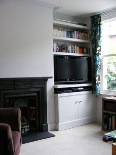 Alcove storage with clever extra-bits-for-telly-etc shelf